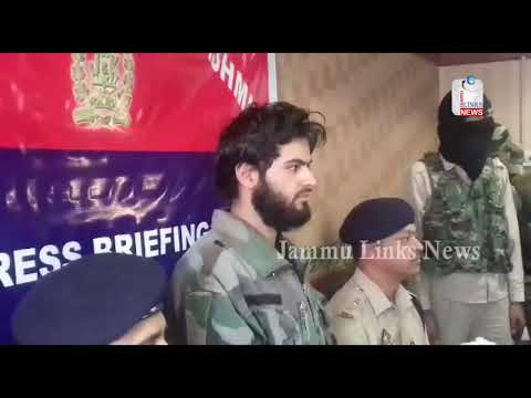 Security forces parade Hizbul Militant caught during encounter in Kashmir