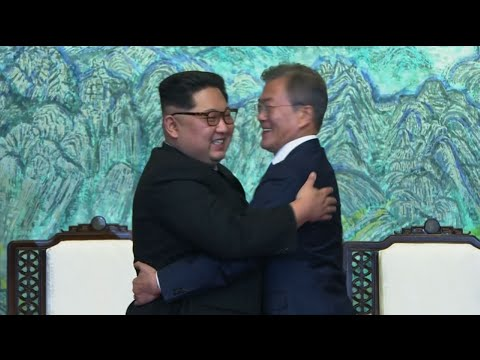 Raw: Kim and Moon Embrace After Talks