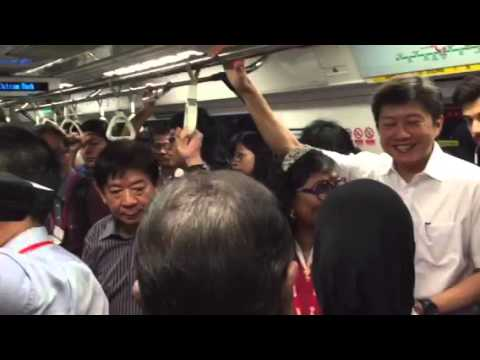 Khaw Boon Wan and Ng Chee Meng taking the train from Tiong Bahru to Outram