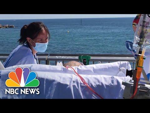 Barcelona Hospital Brings Coronavirus Patients To Beach | NBC News NOW