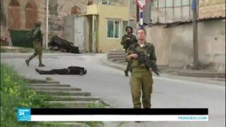 فيديو..تهديد بالحرق لمصور فيديو إعدام جريح فلسطيني