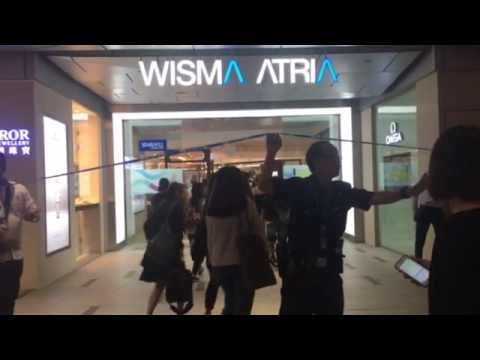 Staff from shops in Wisma Atria return after a fire
