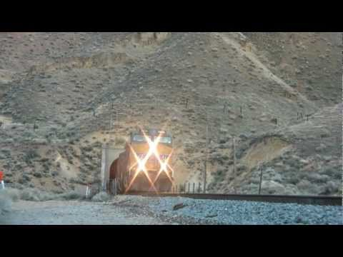 UP blasts out of Carlin tunnel near Elko Nevada. Knocks over Tripod!