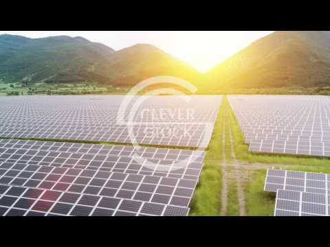 Solar Panels Farm Field Aerial Flight At Sunset Green Energy Conservation Of Power Concept Mountain