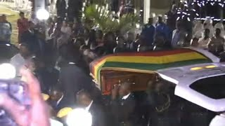 "Coffin of ex-president Mugabe arrives at his former residence ""Blue Roof"" in Harare 