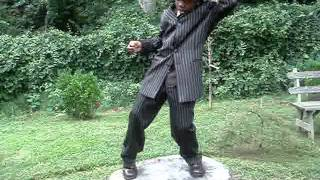 LARRY WILLIAMS III DANCING ON A TREE STUMP  #1.