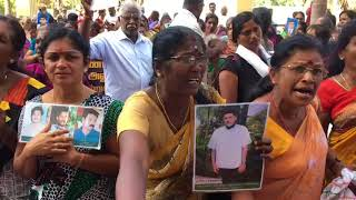 Tamil families of the disappeared protest outside the OMP hearing in Jaffna