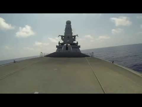 Royal Navy Type 45 Destroyer HMS Dragon (D35) Fires her 4.5 Inch Mark 8 Naval Gun