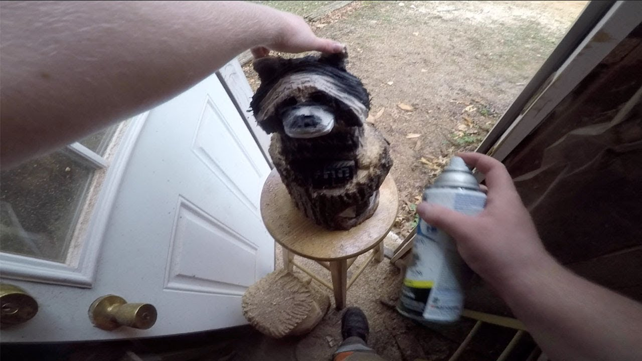 Chainsaw carving raccoons youtube
