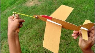 how to make a cardboard paper plane that can fly high||easy rubber band power airplane||paper toy