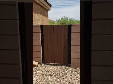 Iron wood gate   Synthetic wood   Affordable Fence and Gates Tucson