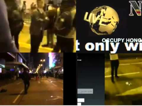 occupy hong kong live protesters beat up cops after 2 shots fired