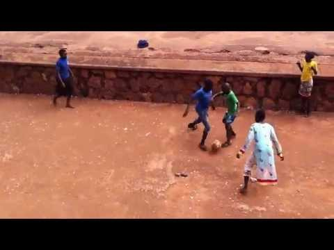 African kids playing soccer/Girls and boys