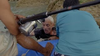 Jeremy's Been Pulled Into The Water By A Goonch Catfish. Can He Keep It On The Line?