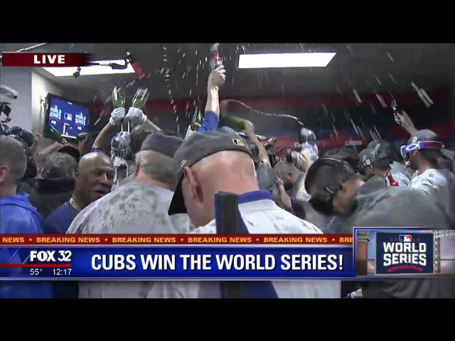 Cubs celebrate with champagne shower in locker room