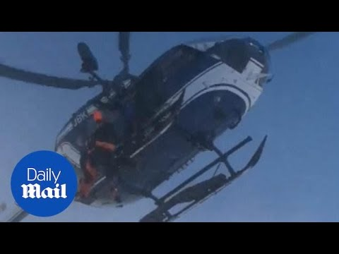 Dramatic moment helicopter rescues injured skier in Alps