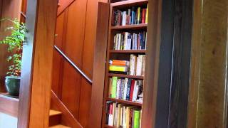 Hidden Staircase Behind Redwood Bookcase