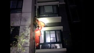 Rescuers Save Boy on Failed Getaway Attempt from Outside Third floor Balcony
