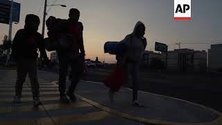 Migrants who stayed in Mexico stadium prepare for next leg of journey