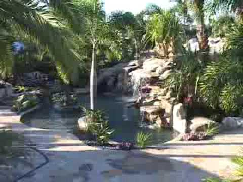 a stunning one of a kind lagoon swimming pool with grotto and waterfalls - Lagoon Swimming Pool Designs