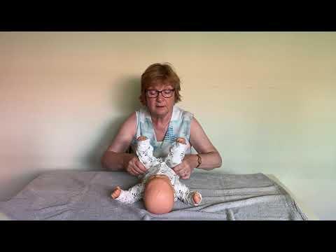 Instructievideo bij een baby met de neiging tot veel strekken en een afplatting middenachter IMG9215