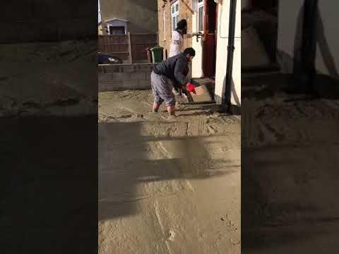 Man walking barefoot in wet concrete