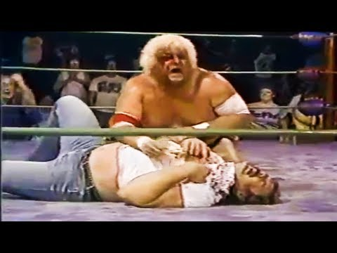 Dusty Rhodes vs The Purple Haze (Kevin Sullivan Stabs BJ Mulligan With The Golden Spike!) (1984)