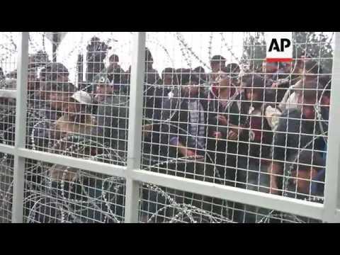 Migrants break fence at border