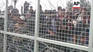 Migrants break fence at border