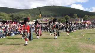 Massed Pipes & Drums afternoon parade during Ballater Highland Games 2018 with a Birthday surprise