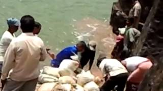 Putting Sand Bags To Stop The Leakage thumbnail