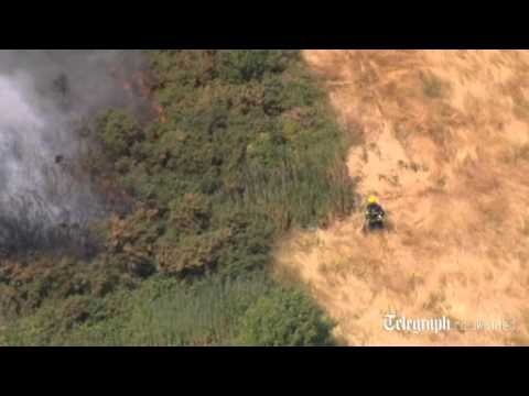 Firefighters Tackle Grass Fire In London