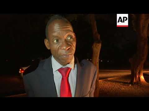 Zimbabwe's finance minister leaves court in Harare