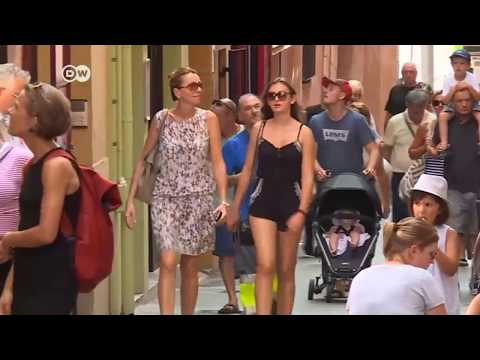Los españoles protestan por el exceso de turismo