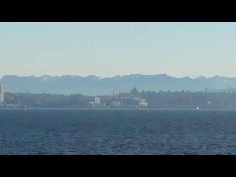 Washington State's Cascade Mountains with Seattle skyline from the Bainbridge Island-Seattle ferry