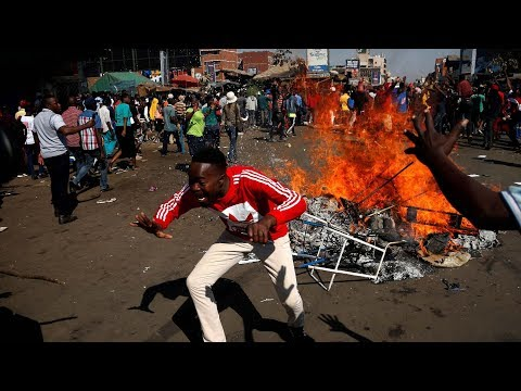 Gunfire disperses angry opposition protesters in Zimbabwe, at least 4 dead