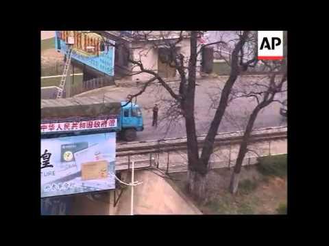 Aid trucks cross border to N Korean rail blast site
