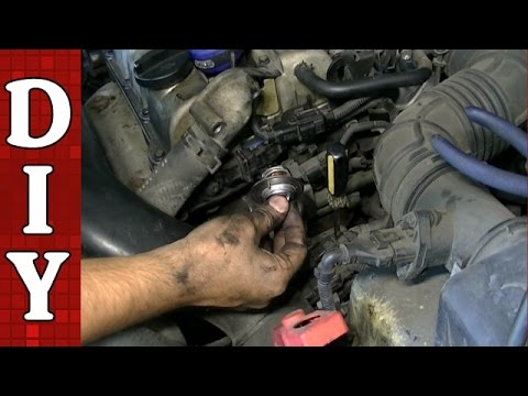 How To Remove And Replace A Thermostat Kia Spectra 1 8l Engine