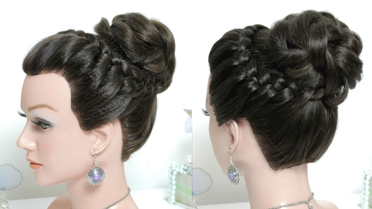 bridal prom hairstyle for long hair. high messy bun updo with