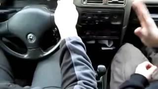 Папа учит сына ездить на машине