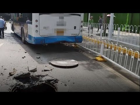 Utility hole explodes underneath bus in central China's Wuhan city