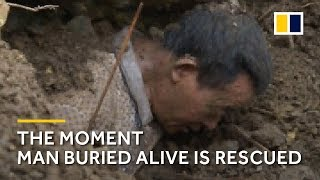 The moment an elderly Chinese man is rescued after being buried alive