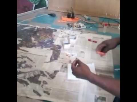 Collage art being made (live) with recycled old newspapers ~ 1