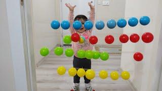 Renkli toplarla eğlenceli oyun oynadık. Eğlenceli çocuk videosu. VAIKAI VAIKAMS!!!