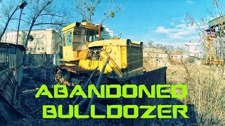 Abandoned bulldozer. Abandoned dozer. Abandoned construction area. Forgotten construction vehicles