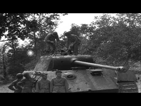 United States soldiers operate captured Mark V panther Tank at Saint Lo in France HD Stock Footage