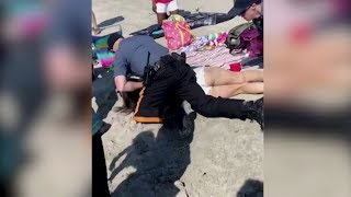 US police officers reassigned after punching woman