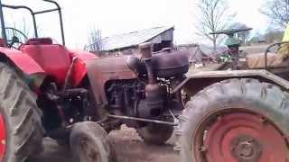 1 cilvēks, 2 traktori :D ievelk un norauj sajūgu ar striķi :D