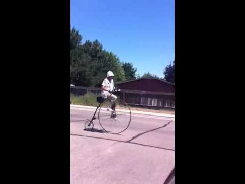 Pith-helmet-wearing velocipedist