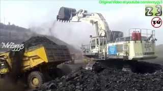 Liebherr R984 Excavator Loading Komatsu HD785 Dump Truck